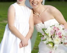 bride-and-flower-girl-in-yard
